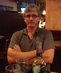 Publisher Tod McCoy wearing one of the necklaces made for Near + Far.