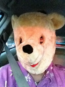 Photo of someone wearing a bear mask