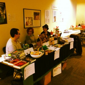 Django Wexler, Janine Southard, and Louise Marley at a book table.
