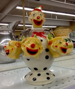 Picture of a teapot shaped like a dead clown.