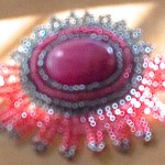 Image of a pink beaded brooch created by speculative fiction writer Ann Leckie, to illustrate piece about her book, Ancillary Justice, for a piece on www.kittywumpus.net