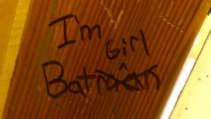 "Graffiti reading ""I am Batgirl"""