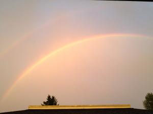 Photograph of a double rainbow.