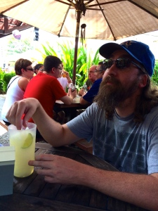 Photo of a man with a drink in Jaco.