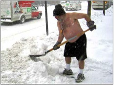 picture of a shirtless man shoveling snow
