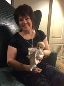 Jane Fancher with doll.