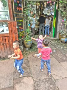 Ancient village with modern kids and bubbles.