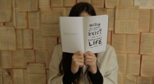 negative-space-woman-reading-philosophy-book-thought-catalog