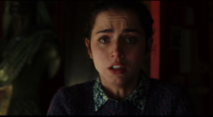 Marta shocked and crying after Harlan has killed himself.