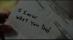 """Underneath lab report handwritten message reads """"I know what you did."""""""