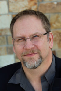 Author Photo of Travis Heermann.